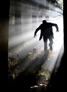 contemporary portrayal of Frankenstein monster running through the woods