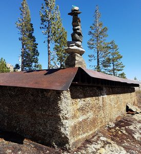 a cairn built on top of the center shaft cap for tunnel #6 at Donner Summit